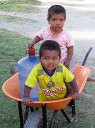 Two Chacahuan kids in a wheelbarrow