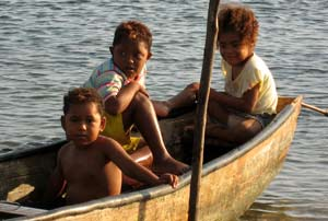 Three kids in a canoe